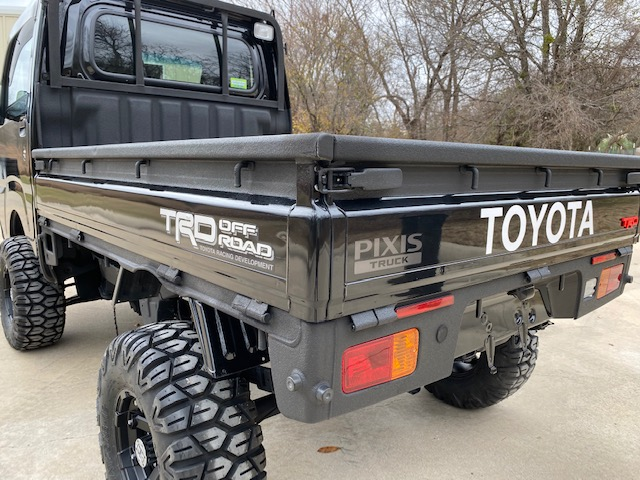 Black Toyota Mini Truck bed